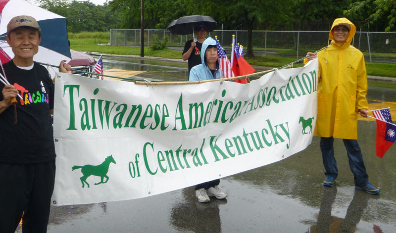 Taiwanese American Association of Central Kentucky parademembers awaittheir place in line at the Fourth of July Parade, Lexington, KY. Photo by Danny Mayer.